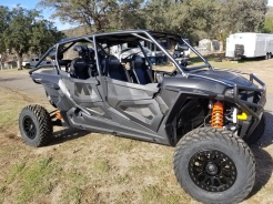Polaris RZR 4 Seater with Houser Racing Roll Cage and Maximum Protection Front Bumper in Black Magic