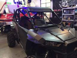 Polaris RZR with Houser Racing Roll Cage