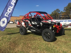 Polaris RZR Turbo with Houser Racing Roll Cage and Sport Front Bumper in Indy Red